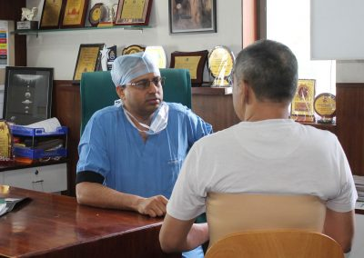 Dr. Pranav Shah - Orthopedic Surgeon in Ahmedabad with Patient